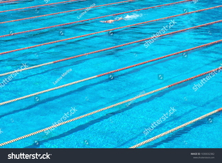 stock-photo-municipal-swimming-pool-texture-of-blue-water-in-the-pool-bright-abstract-background-ideal-for-1030032382.jpg